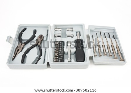 Toolbox set for repair. Pliers and Screwdriver with different nozzles on white background - stock photo