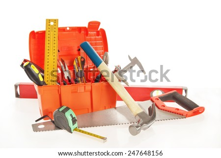 Toolbox with various working tools isolated over white - stock photo