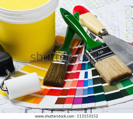 tools and accessories for home renovation are on architectural drawings - stock photo