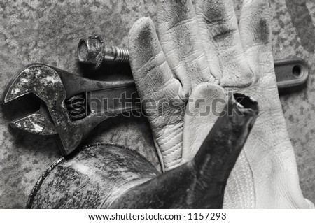 tools and glove in black/white