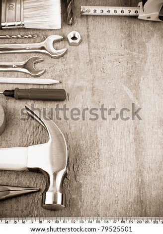 tools and instruments at wooden board on sepia - stock photo