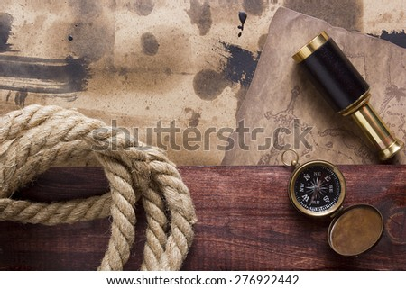 Tools and items associated with travel, map, telescope and rope. - stock photo