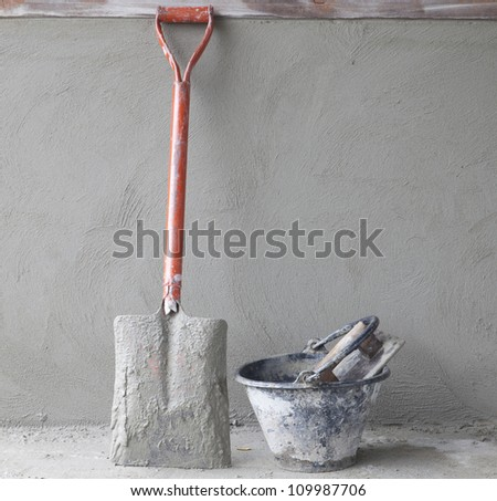 tools construction worker on wall concrete. - stock photo