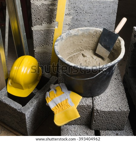 Tools for bricklayer bucket with a solution and a trowel - stock photo