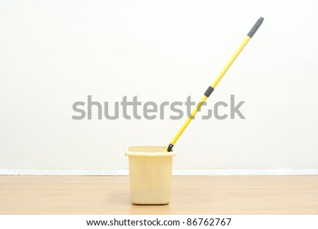 Tools for cleaning isolate on wood floor a white wall. - stock photo