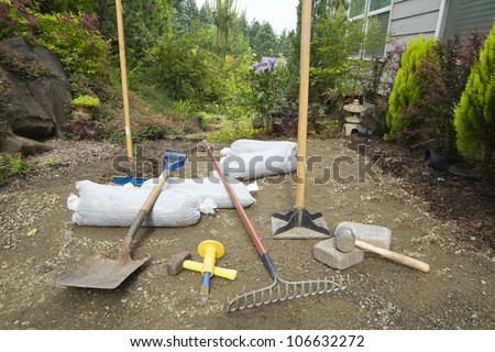 Tools for Excavating and Laying Pavers for Backyard Garden Patio - stock photo
