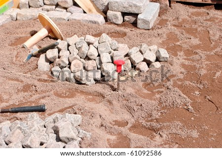 tools for working stone hammer chisel - stock photo