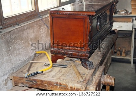 tools in a dusty carpentry workshop expert in restoration of antique furniture - stock photo
