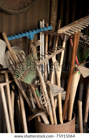 Tools in dark shed on a farm - stock photo