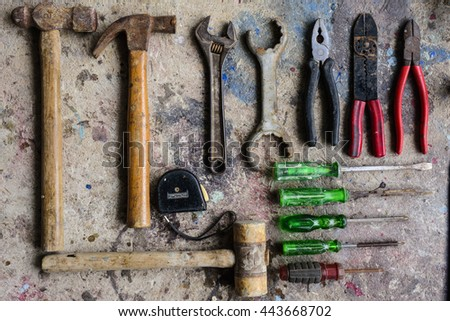 Tools lay on the cement. - stock photo