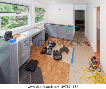 Tools left out during lunchbreak while installing custom cabinets in master bathroom - stock photo