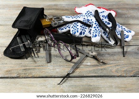 Tools of picking locks on wooden table