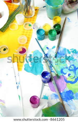 Tools of the artist: paints, brushes and a paper