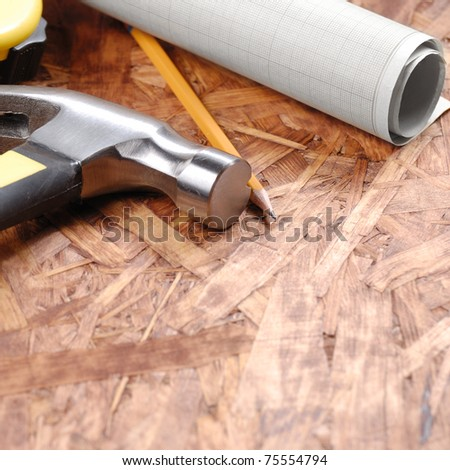 Tools on the plywood - stock photo