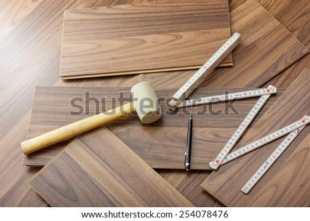 tools to laying laminate  - stock photo