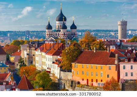 Toompea hill with tower Pikk Hermann and Russian Orthodox Alexander Nevsky Cathedral, view from the tower of St. Olaf church, Tallinn, Estonia - stock photo