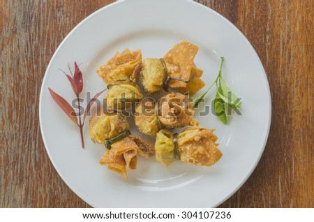 Toong thong. Thai food .oriental deep fried wontons filled with prawn and spring onion, served with dumpling and chili sauces. select focus. - stock photo