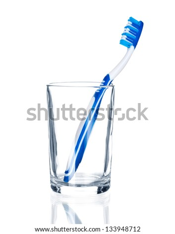 tooth brush in glass. Isolated on white background