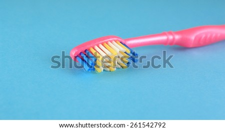 Tooth-brush over blue. Shallow DOF. - stock photo