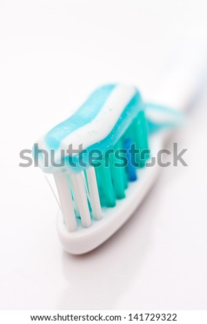 Tooth paste on bush, close up image. Dental hygiene concept.