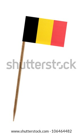 Tooth pick wit a small paper flag of Belgium - stock photo