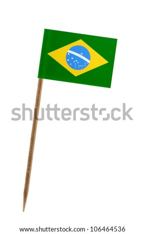 Tooth pick wit a small paper flag of Brazil - stock photo
