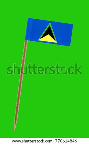 Tooth pick wit a small paper flag of St. Lucia on a green screen for chromakey