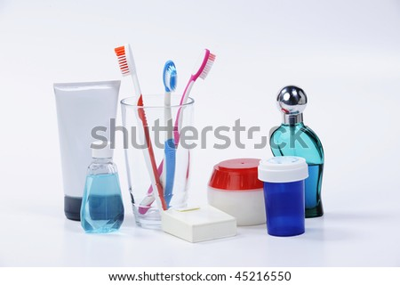 toothbrush and medicine isolated on white - stock photo