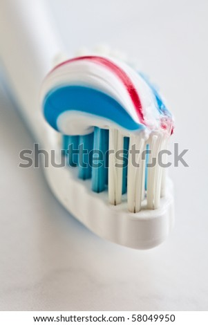 Toothbrush and toothpaste closeup. - stock photo