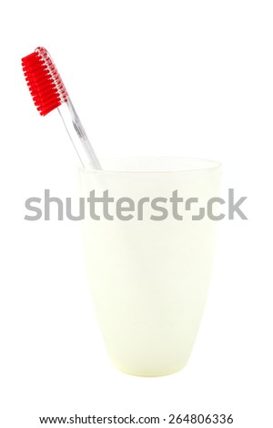 Toothbrush in a glass isolated on a white background. - stock photo