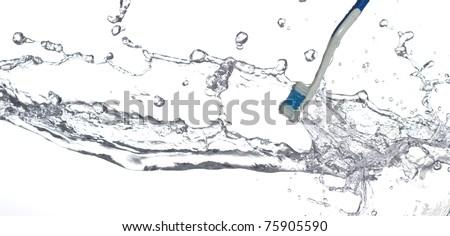 Toothbrush in fresh water - stock photo