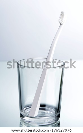 Toothbrush in glass on light grey background