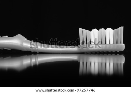 Toothbrush on Black Background - stock photo
