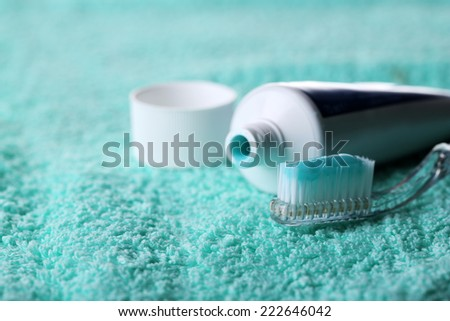 Toothbrush with blue toothpaste on towel, close up - stock photo