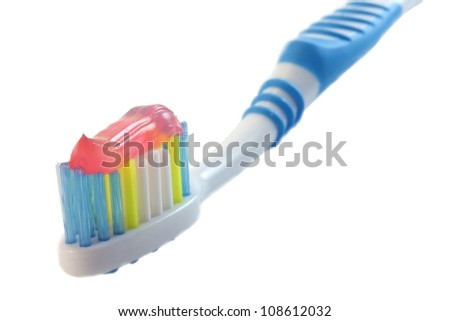 Toothbrush with red toothpaste isolated on white