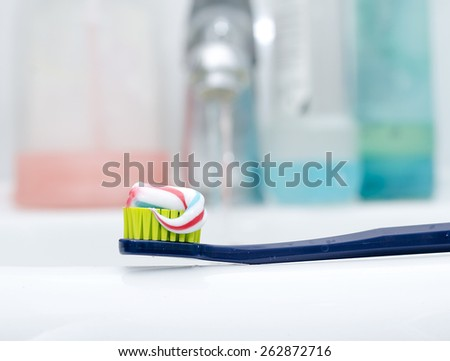 Toothbrush With Toothpaste at the sink as the concept of dental hygiene - stock photo
