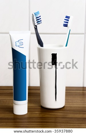 Toothbrushes in cup - stock photo
