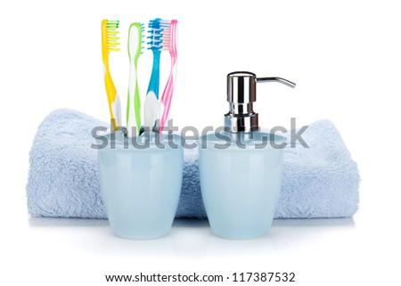 Toothbrushes, liquid soap and towel. Isolated on white background