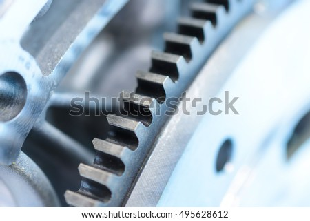 Toothing of automotive engine flywheel. Gear closeup.