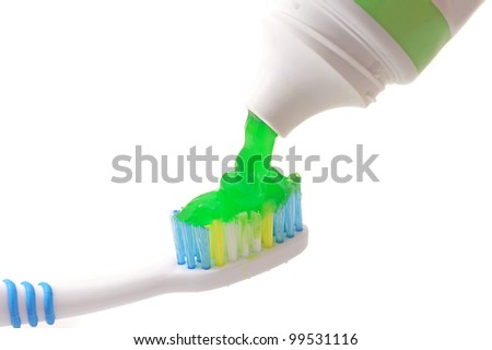 Toothpaste coming out of a tube on Toothbrush on white background - stock photo