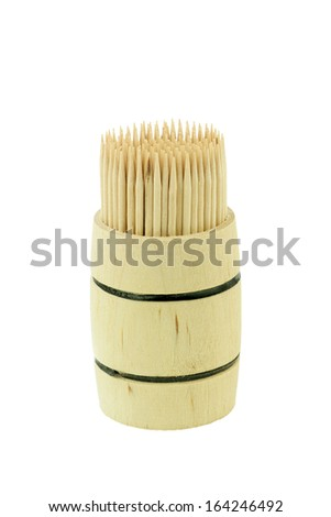 toothpicks / cocktail sticks in a wooden barrel on a white background. - stock photo