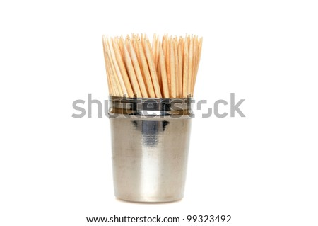 Toothpicks in front of a white background