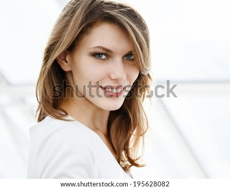 Toothy smile / photo of beautiful brunette woman  - stock photo