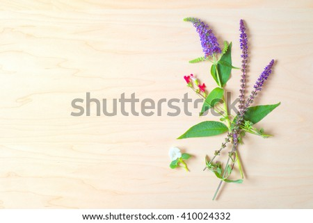 Top Above View of Pretty Purple, Red and White Flower bunch in Casual Arrangement on Natural Rustic wood board background with room or space for copy, text, your words.  Horizontal with modern look. - stock photo
