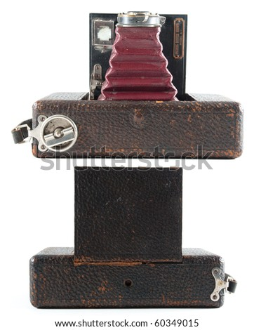 top and bottom view of an antique bellowed film camera on an isolated white background. - stock photo