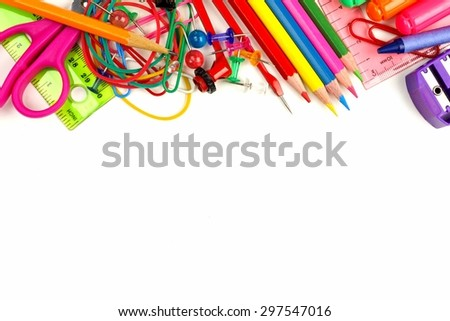 Top border of colorful school supplies on a white background  - stock photo