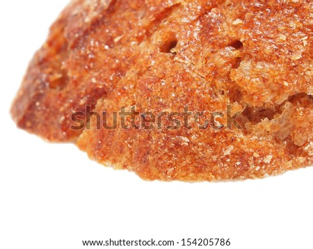 Top crust of rye bread isolated on a white background. Close up. Shallow depth-of-field. - stock photo
