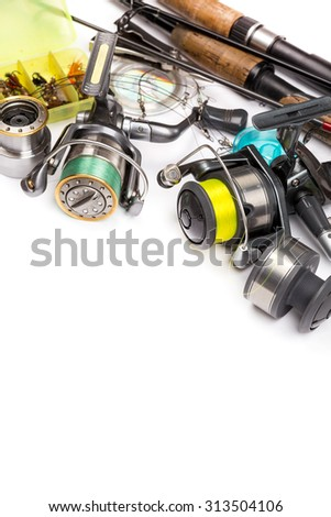 top different fishing tackles - rod, reel, line and lures on white background - stock photo
