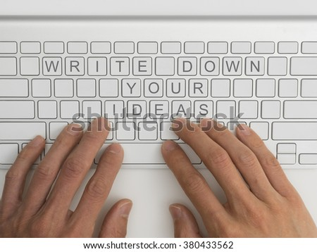 Top down view of keyboard with the words write down your ideas