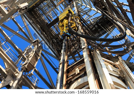 Top Drive System (TDS) Spinning for Oil Drilling Rig - stock photo